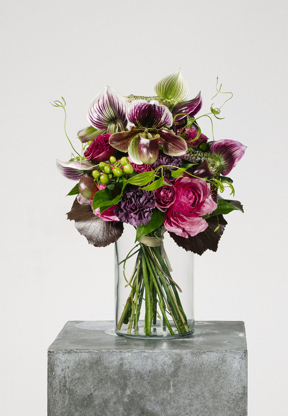 flower bouquet of orchid and ranunculus by flannel flowers