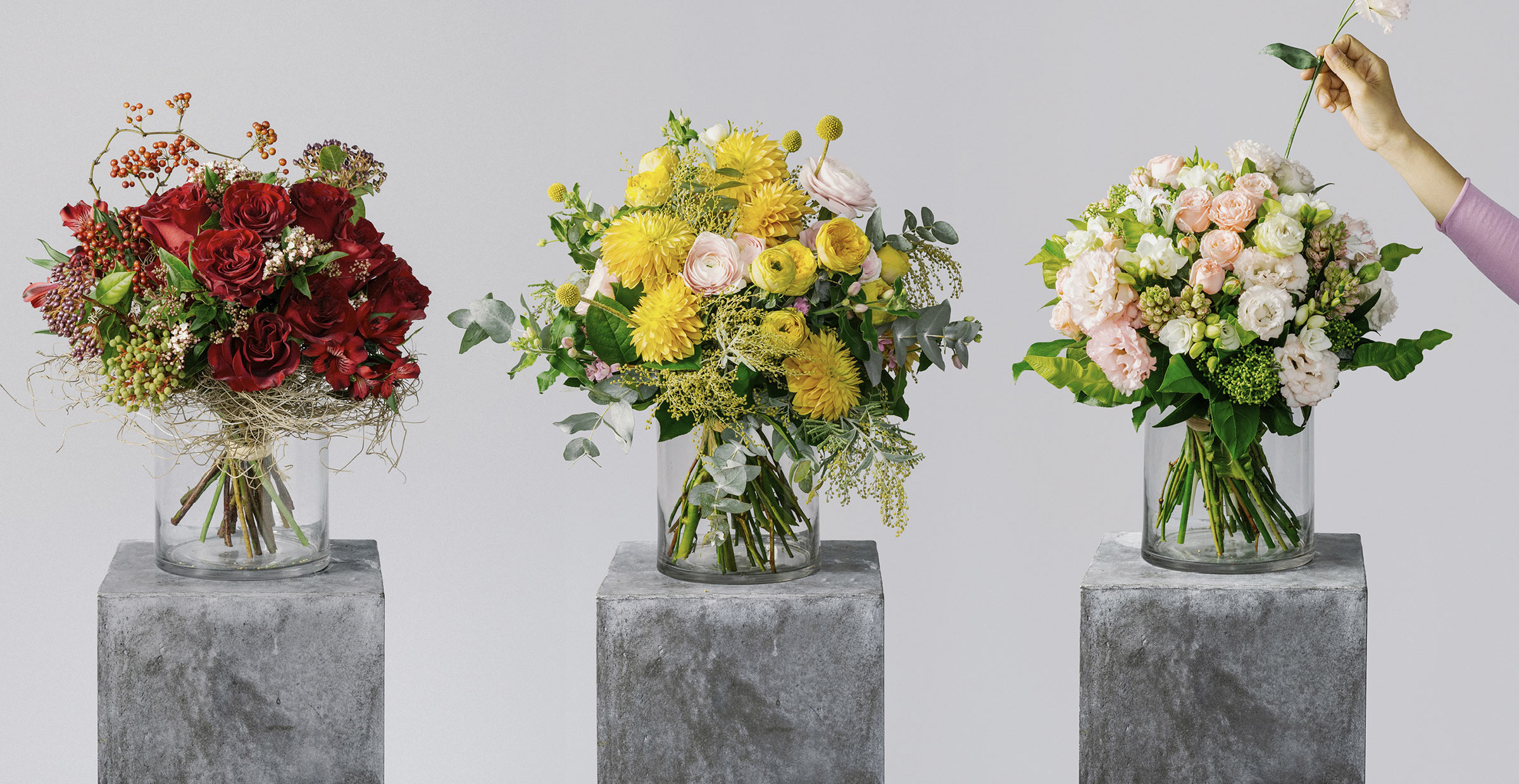 Banner image of red rose, yellow ranunculus and eustoma flower bouquets for the bespoke collection