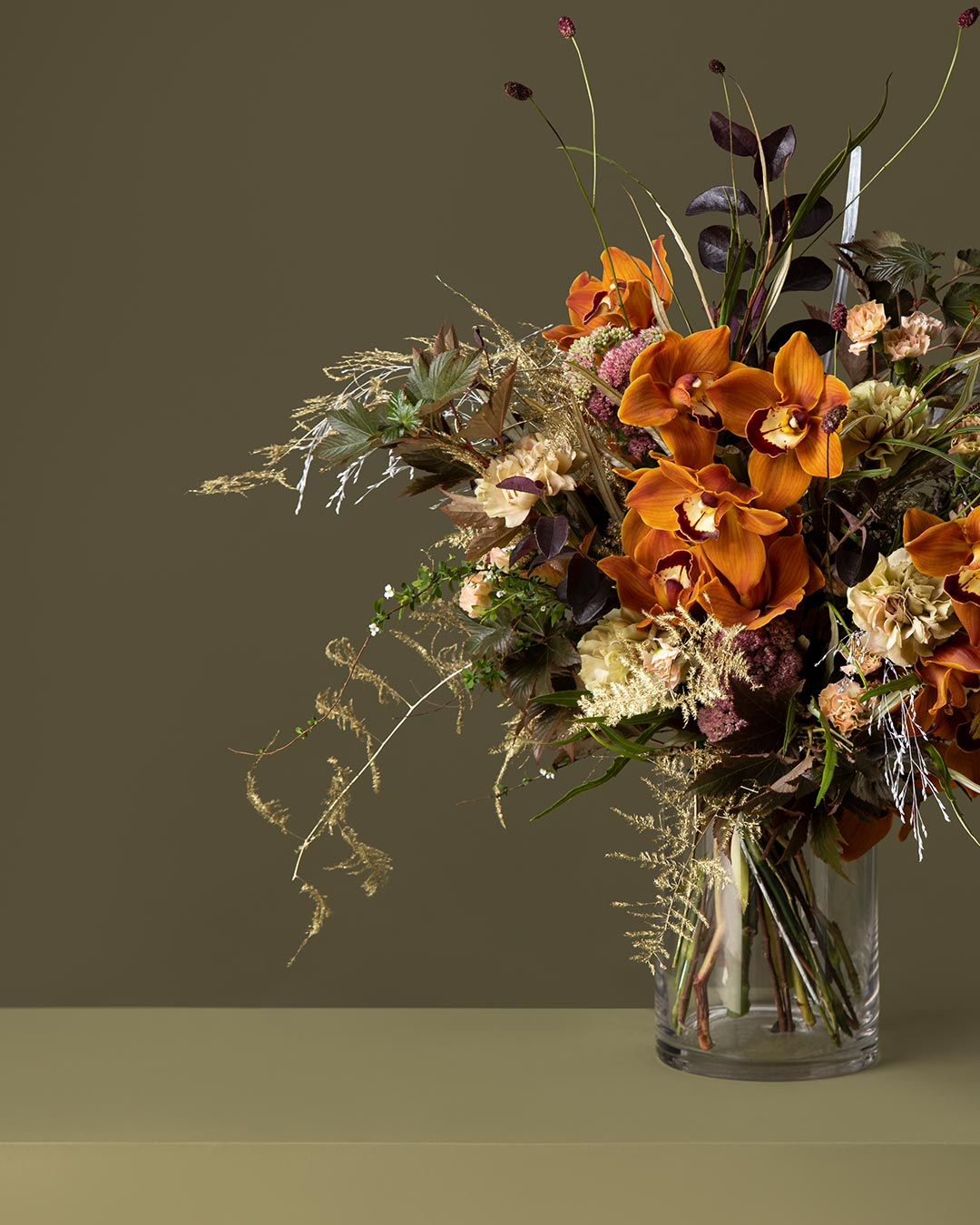 Banner image of flower bouquet of golden orchids for the online flower collection