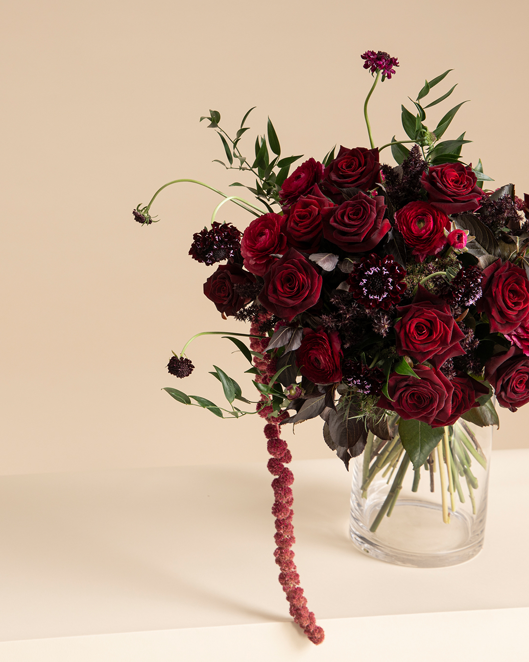 Mobile banner image of Rose Noir flower bouquet of Carnation and Ranunculus for the online flower collection